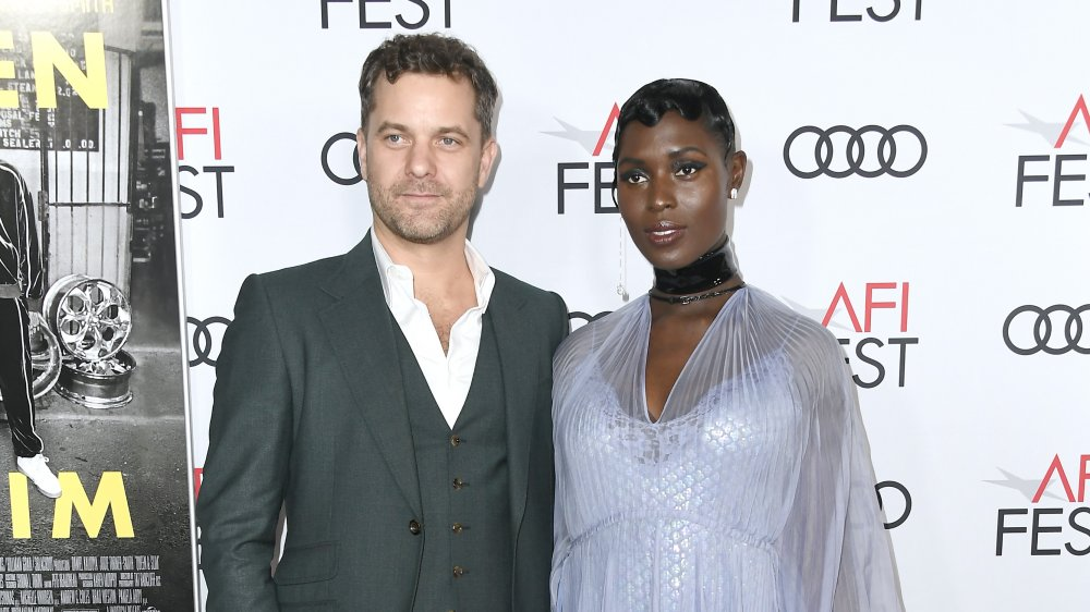 Joshua Jackson, Jodie Turner-Smith posing together on red carpet