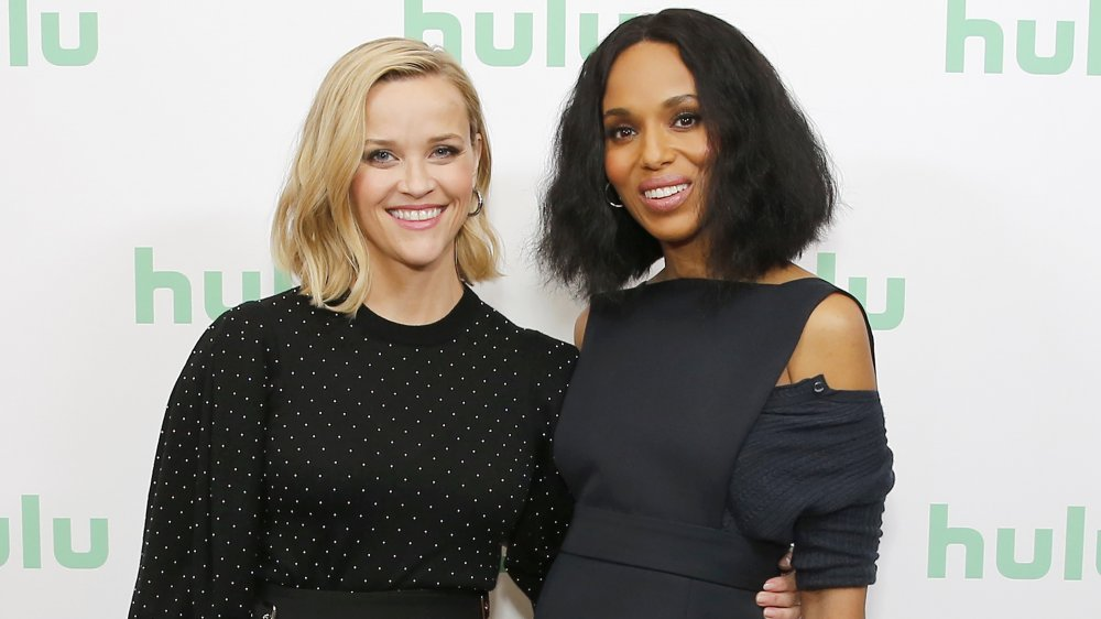 Reese Witherspoon and Kerry Washington arm in arm on red carpet