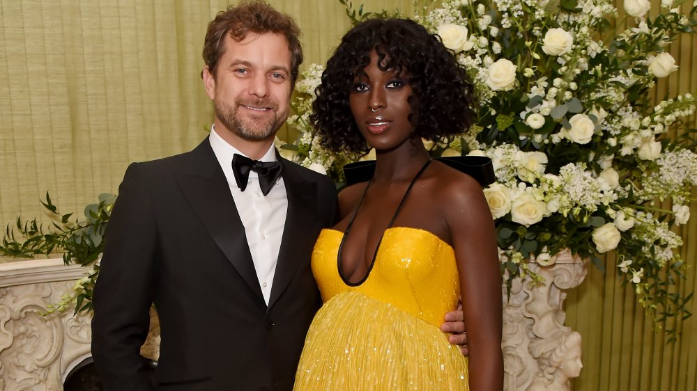 Joshua Jackson in a suit and Jodie Turner-Smith in a yellow dress