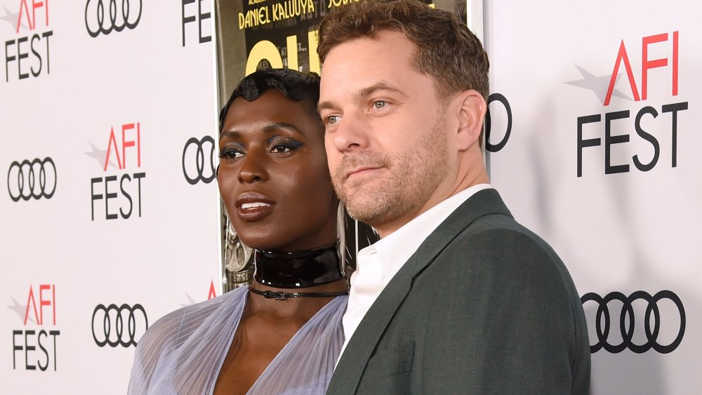 Jodie Turner-Smith in a tulle dress next to Joshua Jackson