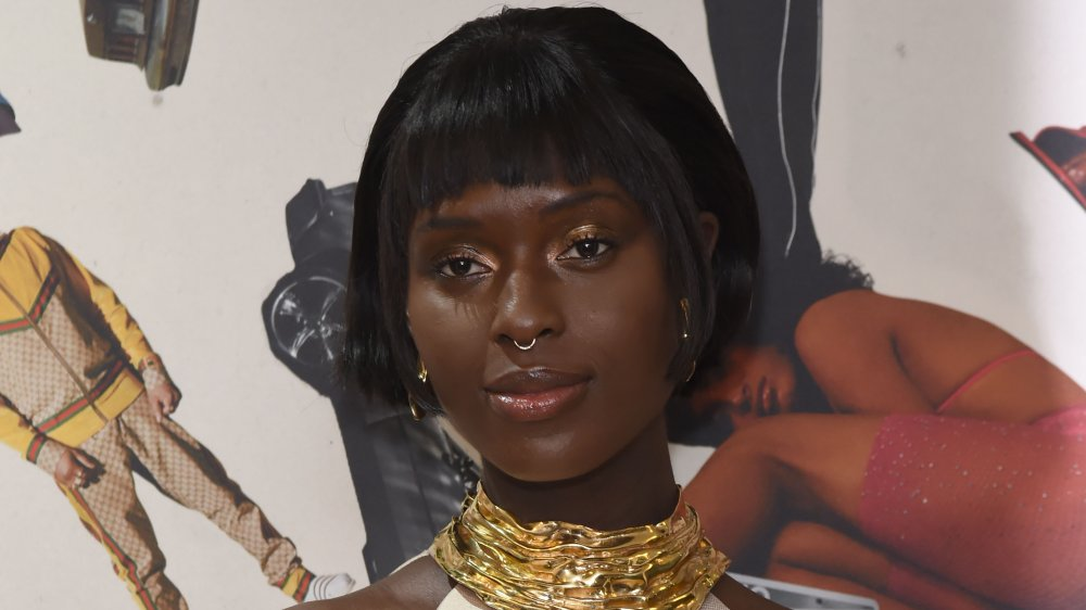 Jodie Turner-Smith with a nose ring and chunky gold necklace