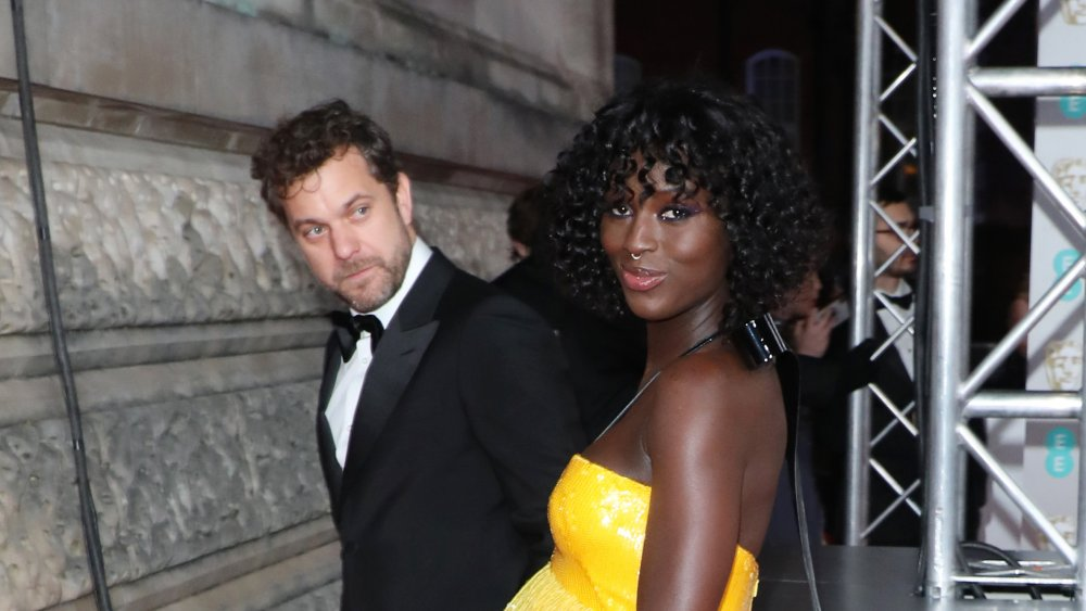 Joshua Jackson in a suit with Jodie Turner-Smith in a yellow dress